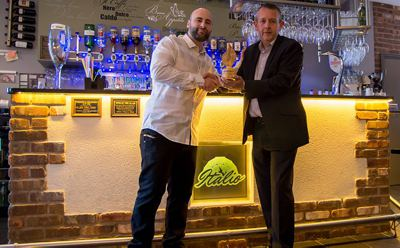 Italio pizza restaurant recieveing the first Woody Award